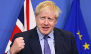 British Prime Minister Boris Johnson shows his satisfaction after reaching a deal even before the EU summmit in Brussels began. (© picture-alliance/dpa)