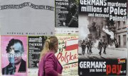 Posters in Warsaw calling for war reparations payments from Germany. (© picture-alliance/dpa)