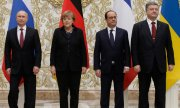 The leaders of Russia, Germany, France and Ukraine signed a 13-point plan for peace in Donbass. (© picture-alliance/dpa)