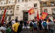 Trade unionists protesting the repeal of the legal protection in Rome in July 2019. (© picture-alliance/dpa)