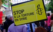 Anti-torture protests already took place in Paris in 2012. (© picture-alliance/dpa)