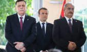 Al-Serraj, Macron, Haftar (l. to r.). (© picture-alliance/dpa)