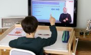 A boy takes part in a class broadcast by Turkish state television. (© picture-alliance/dpa)