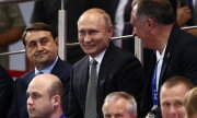 Putin at a boxing match in Minsk. (© picture-alliance/dpa)