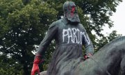 "A statue of Belgium's King Leopold II was tagged with the word ""Apologies"" during the BLM protests in Brussels in mid-June. (© picture-alliance/dpa)"