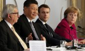 Jean-Claude Juncker, Xi Jinping, Emmanuel Macron and Angela Merkel on 26 March 2019 in Paris. (© picture-alliance/dpa)