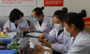 Disease Control and Protection Center staff in Hohhot, China. (© picture-alliance/dpa)